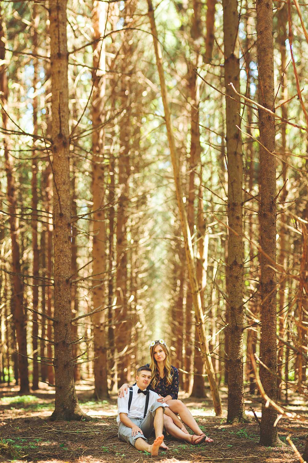 Engagement photo in row of trees