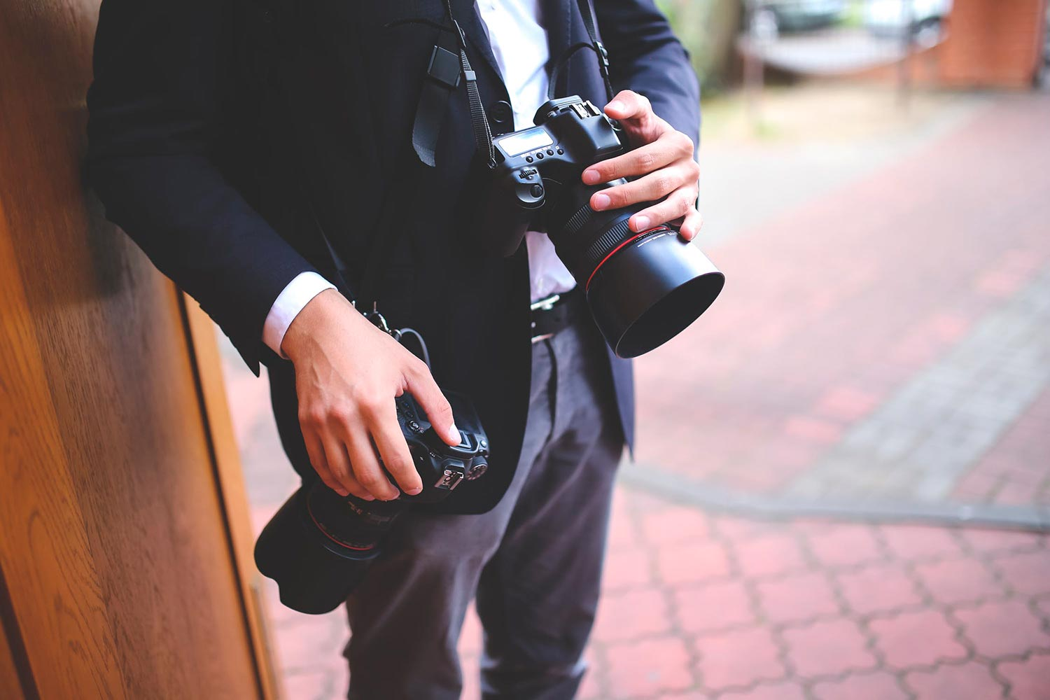 Wedding Photographer holding two cameras - article thumbnail