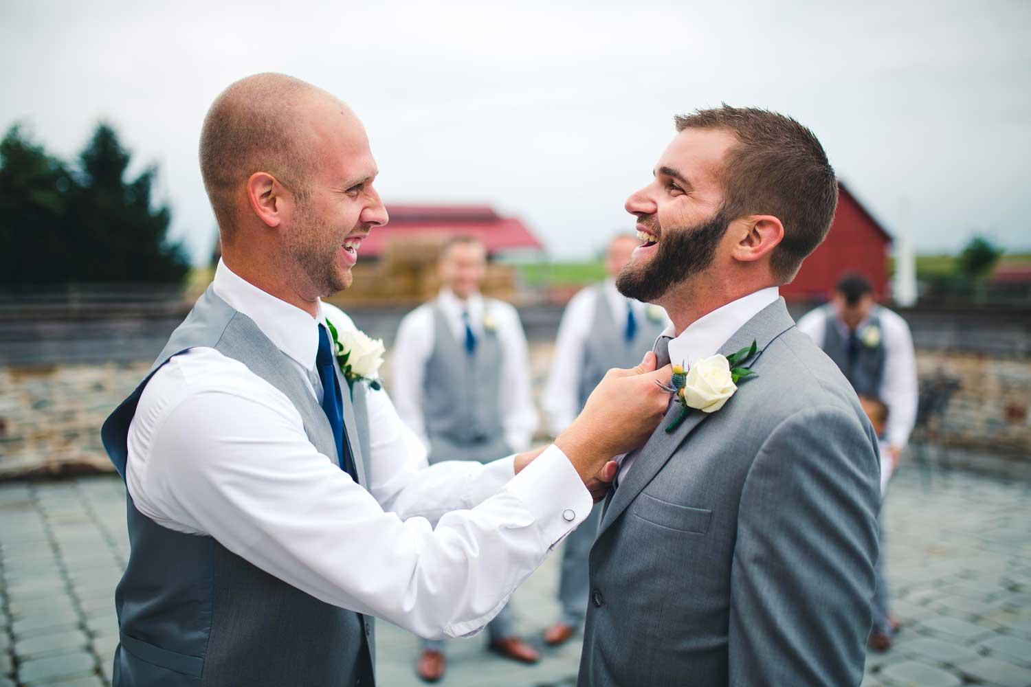 Best man adjusting tie
