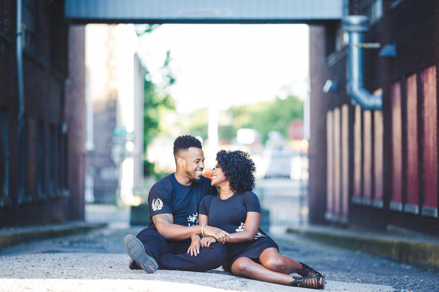 Couple poses sitting together in Wyomissing PA photo shoot