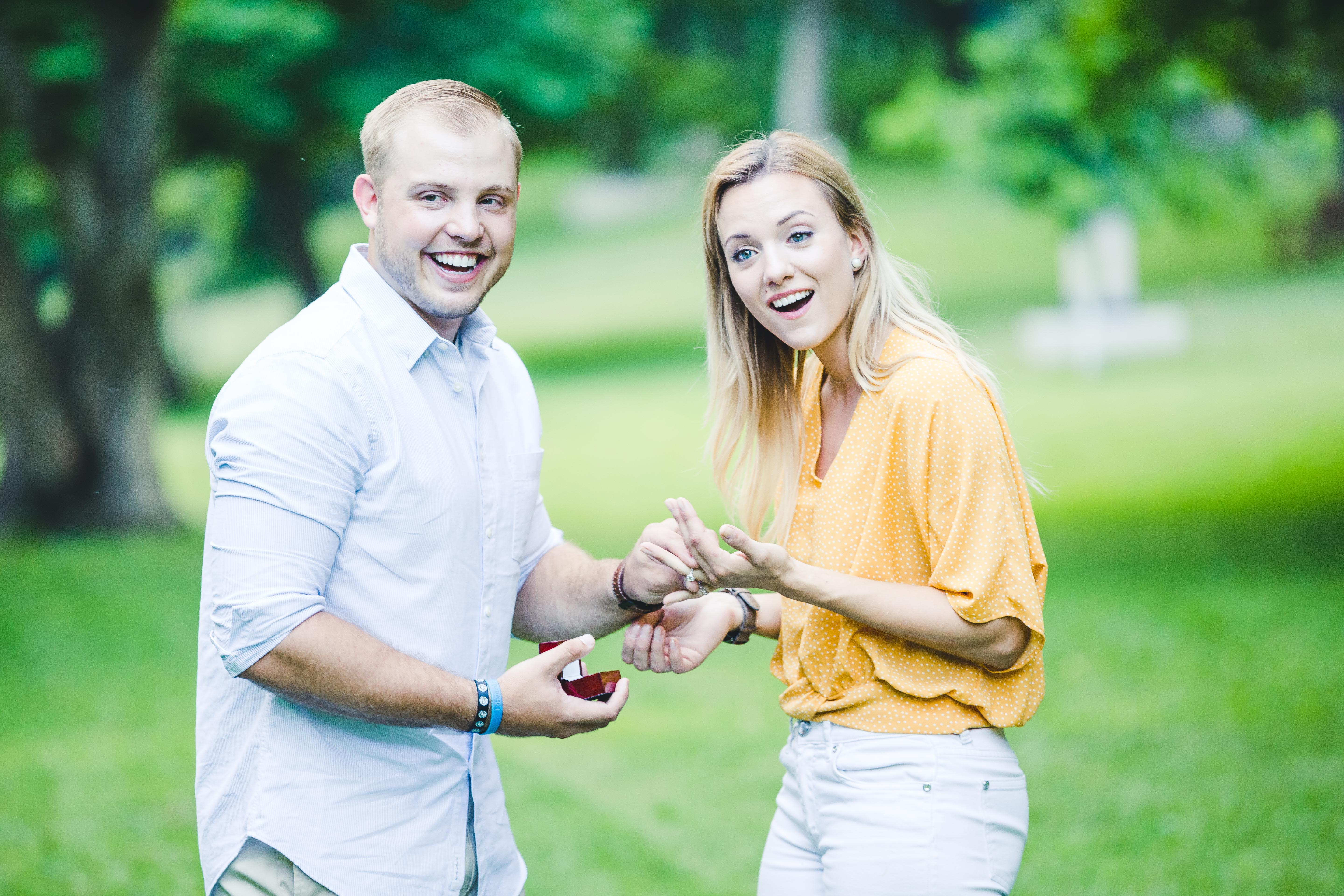 Couple looking off camera at son after surprise engagement