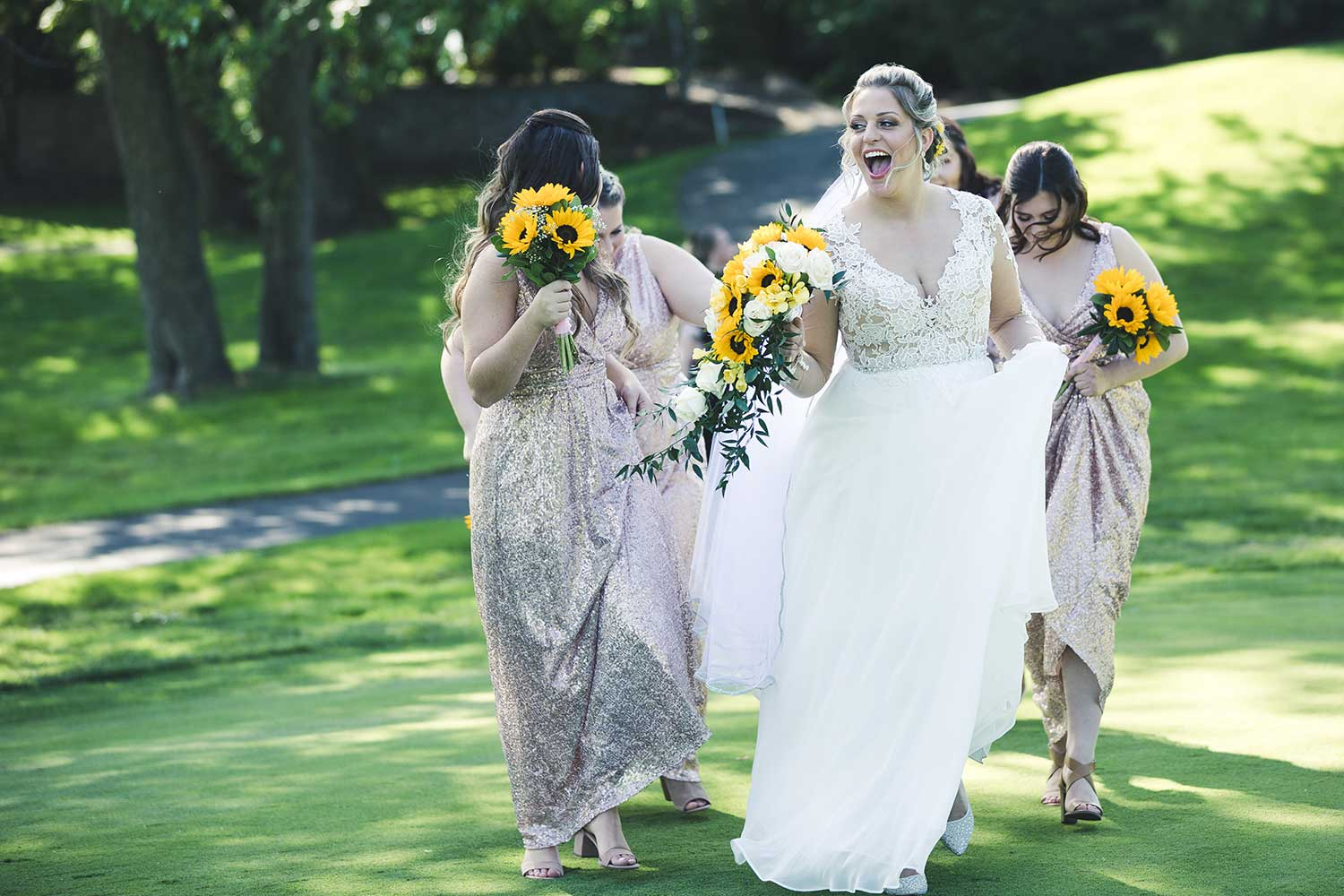 Bride and bridal party laughing