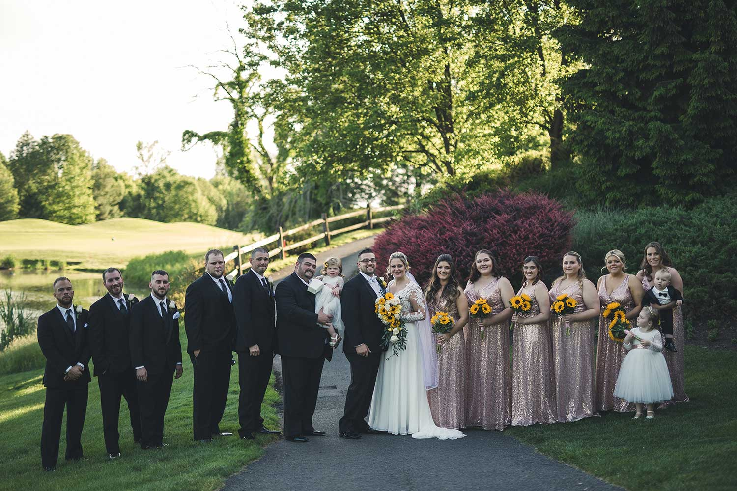 Group photo of both wedding parties at Manor House at Commonwealth