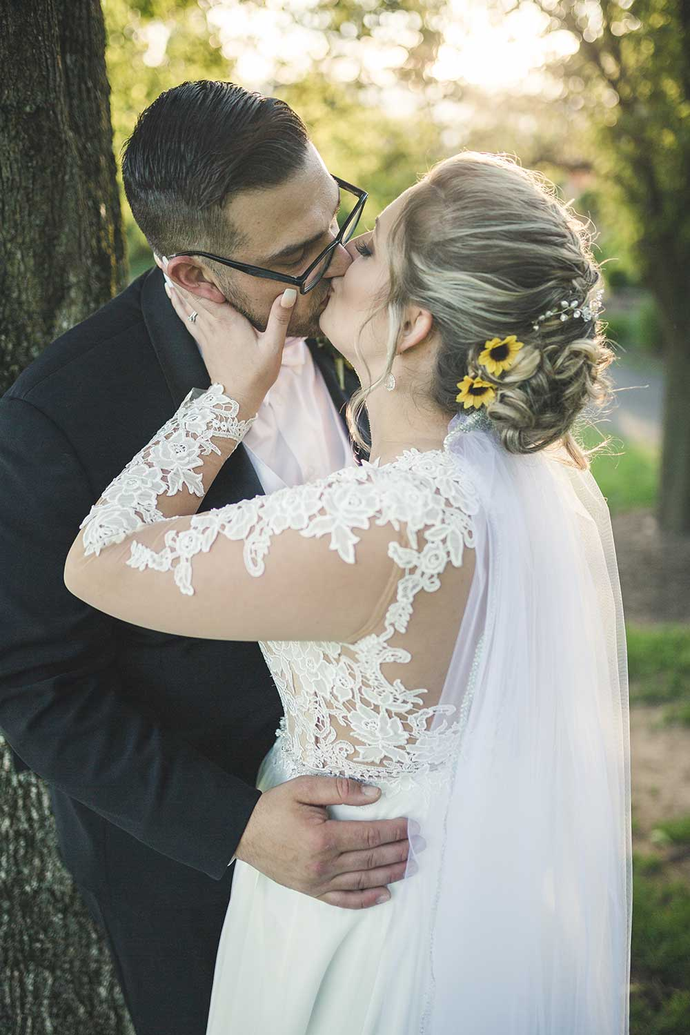 Bride and groom kissing at Manor House at Commonwealth