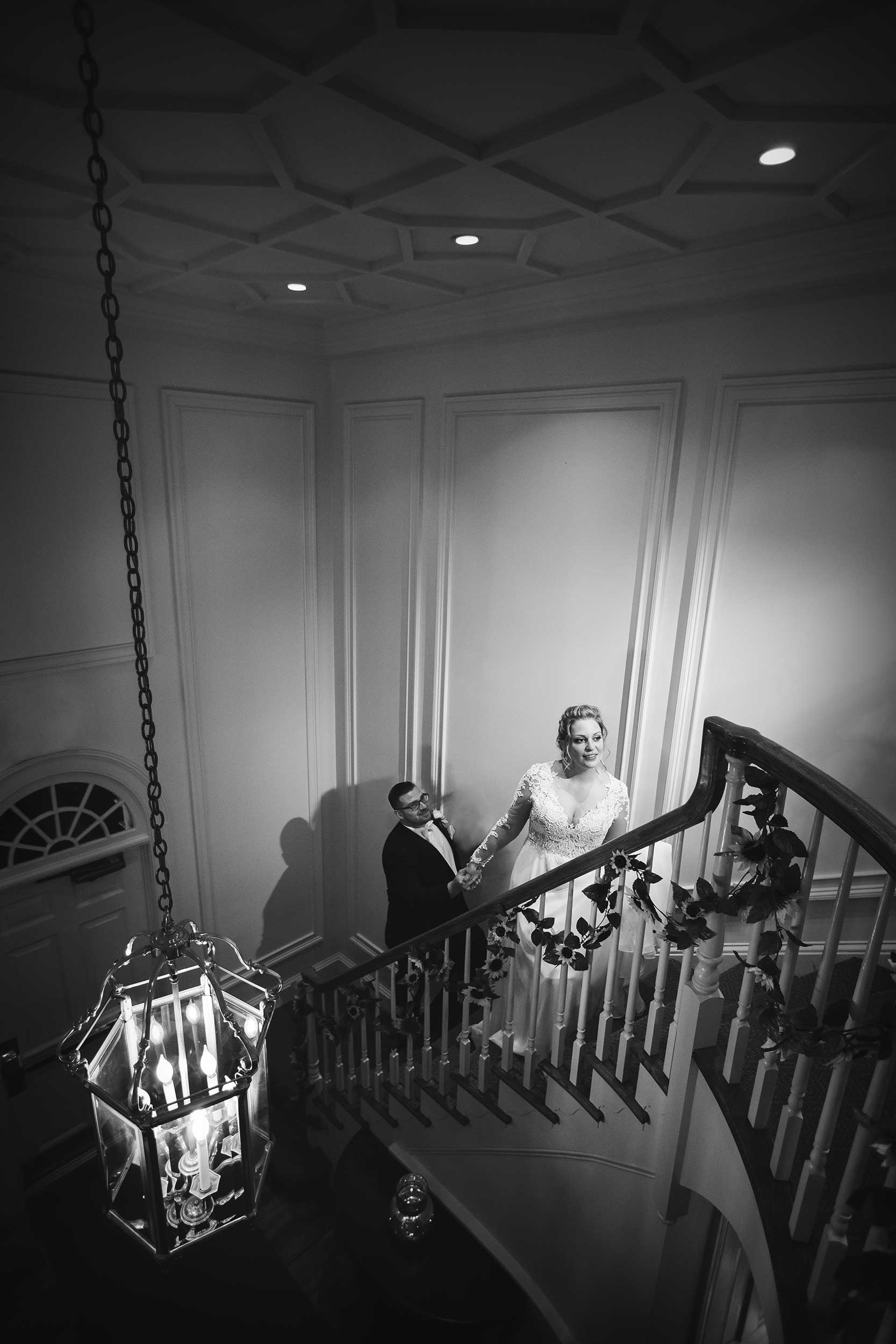 Bride and groom on the staircase at Manor House at Commonwealth