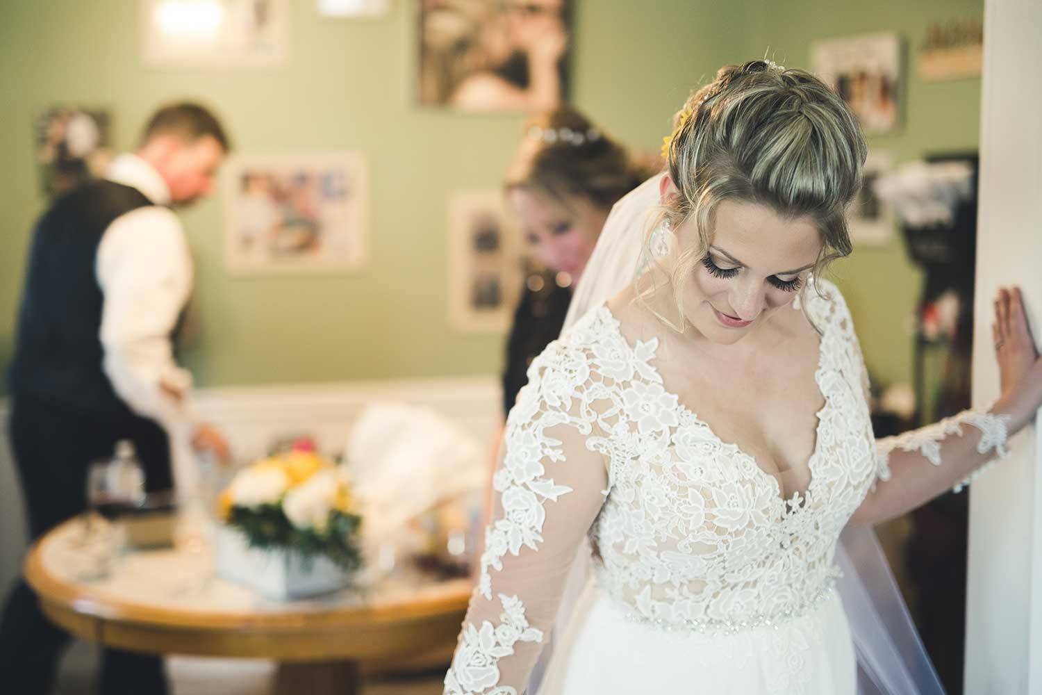 Bride admiring her dress
