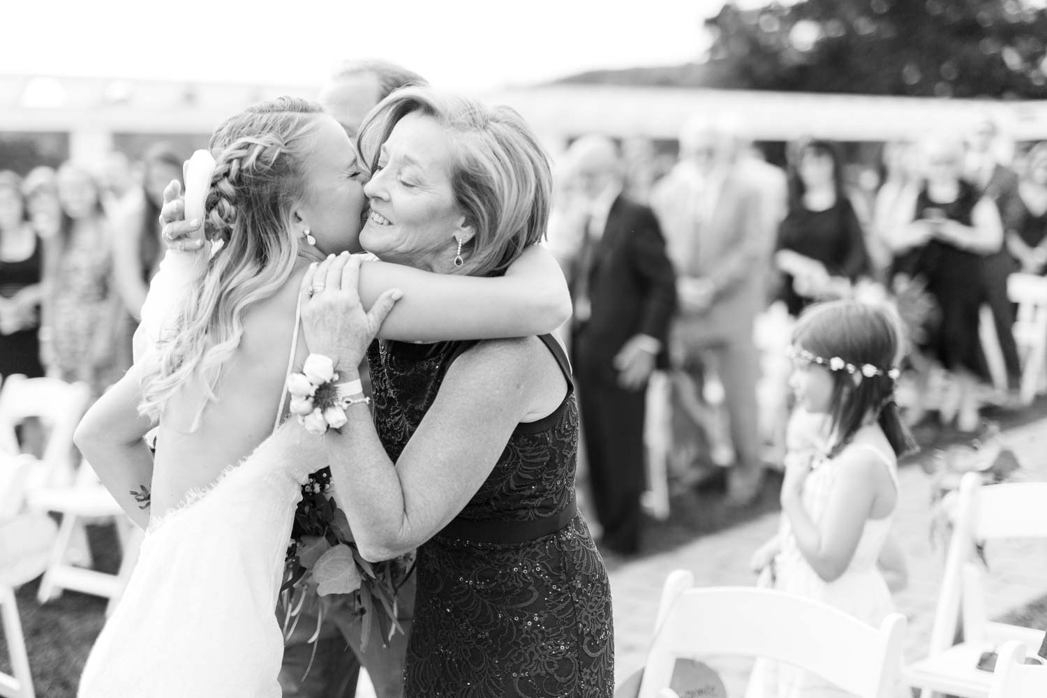 Bride hugging her mother at the alter