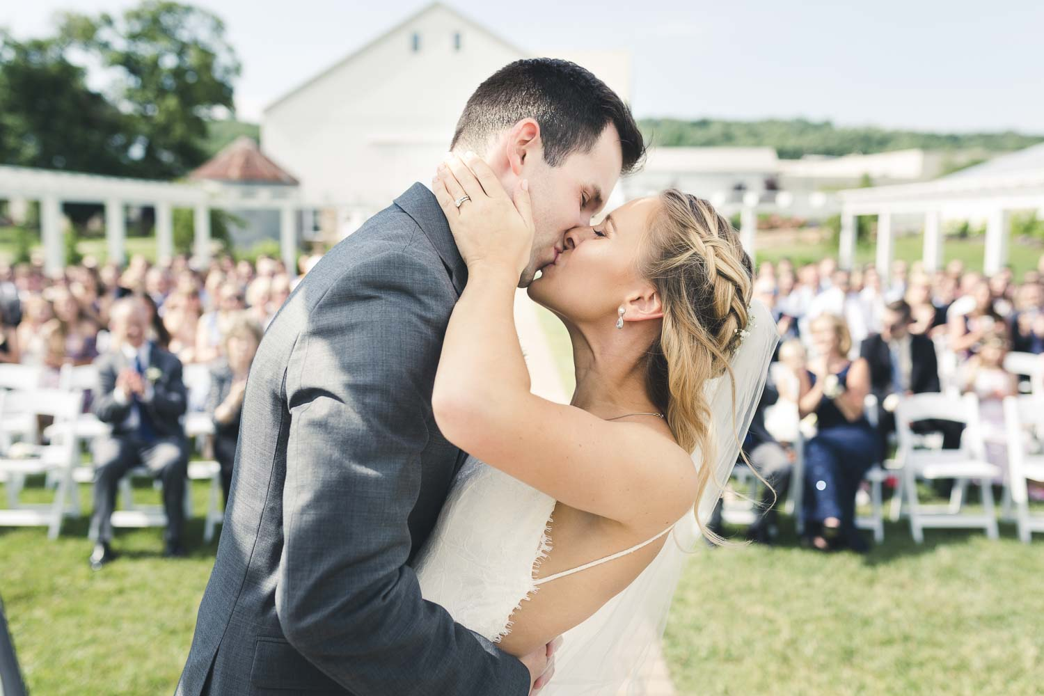 Fist kiss at the Barn at Stoneybrooke