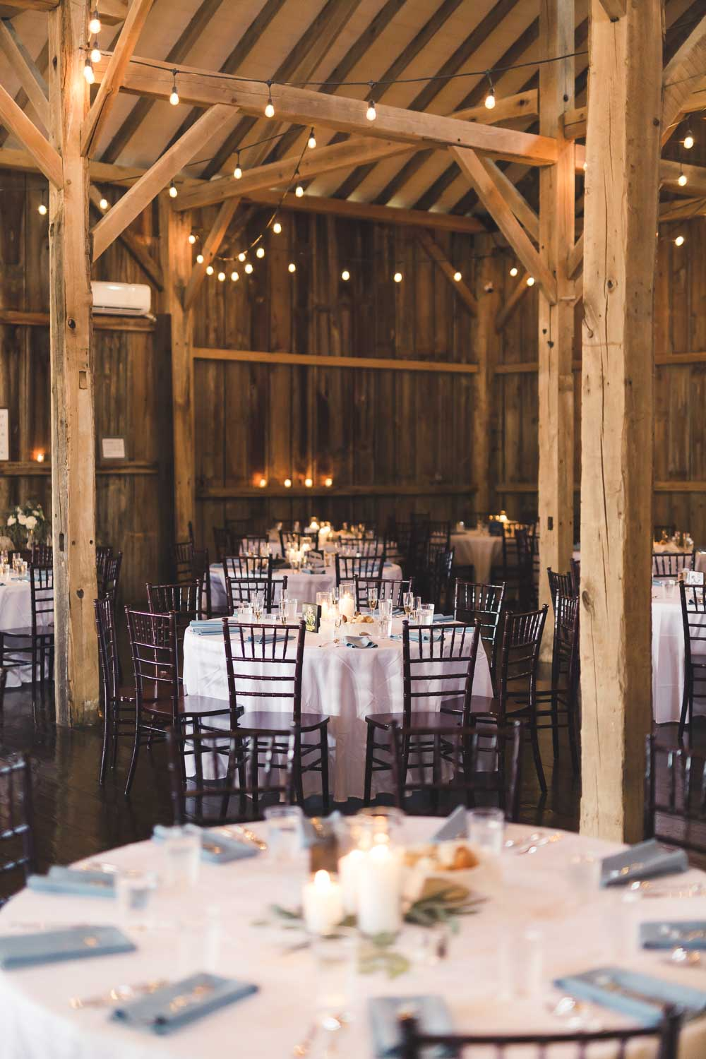 Barn wedding venue with table settings