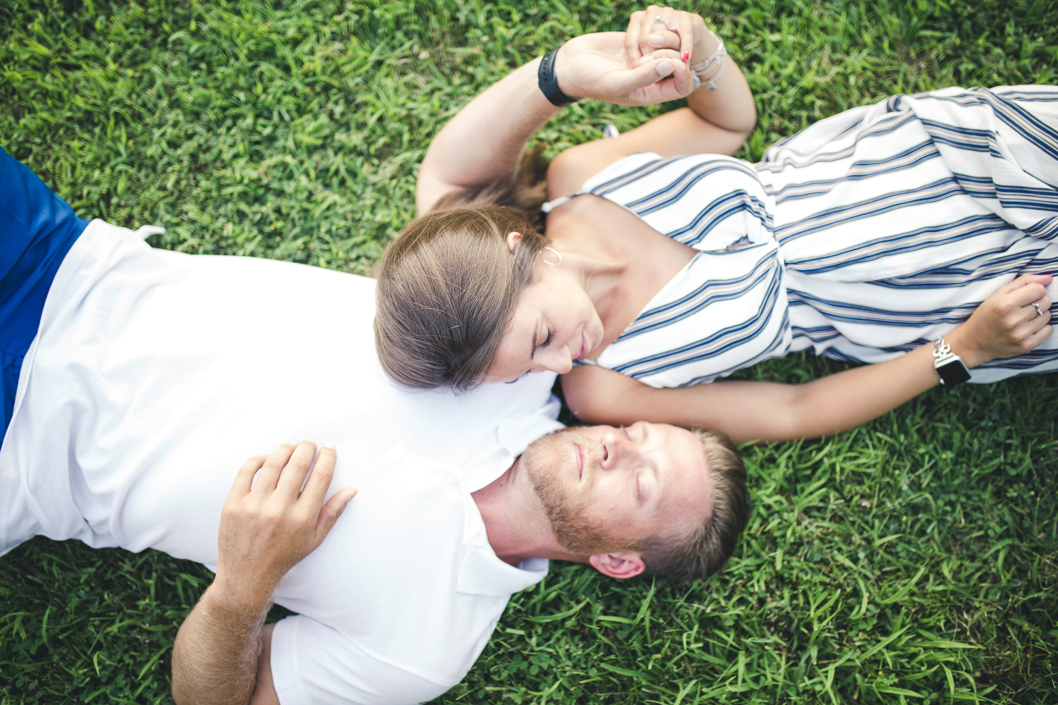 Couple laying in the grass together Lockridge Park