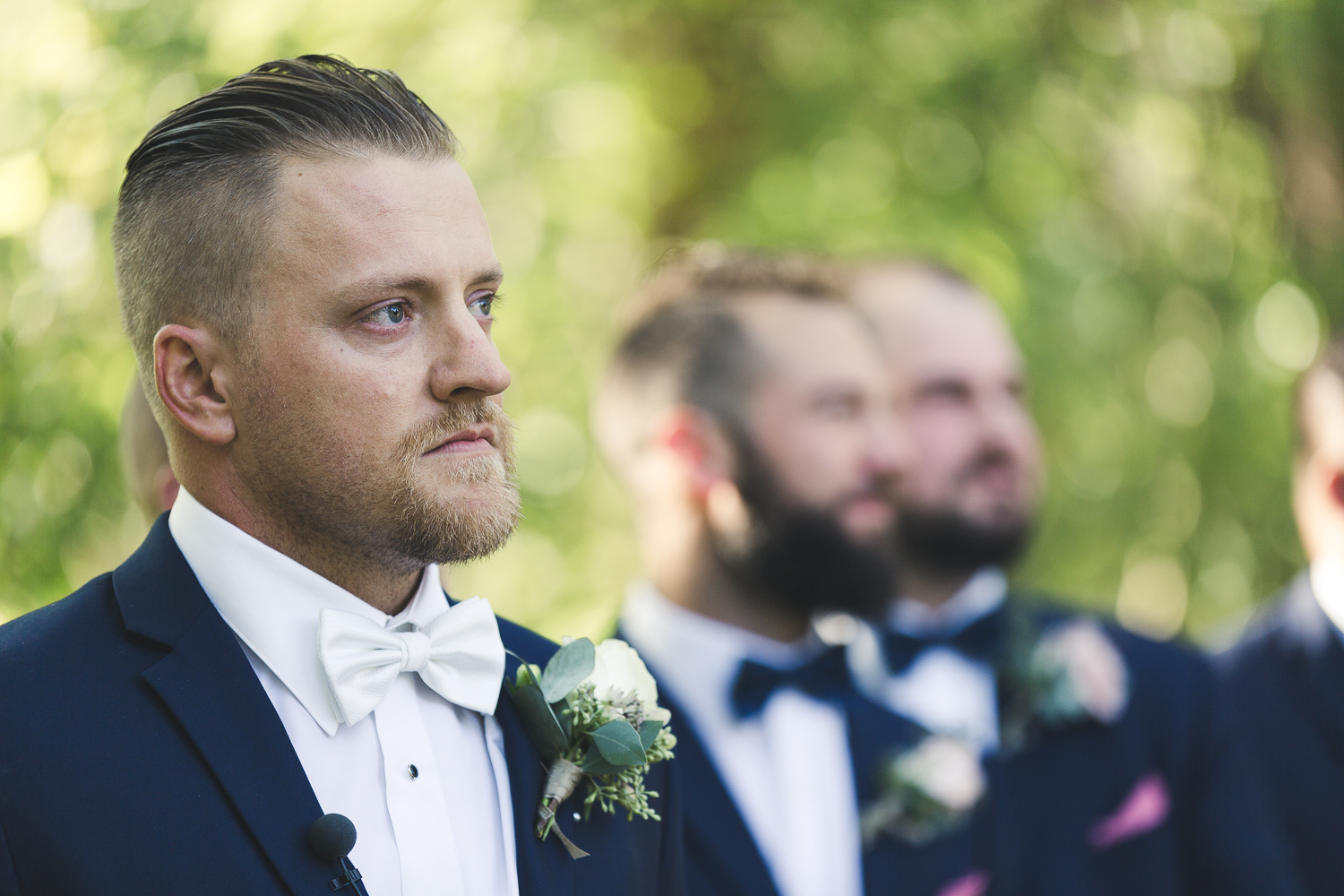 Groom seeing the bride walk down the aisle for the first time