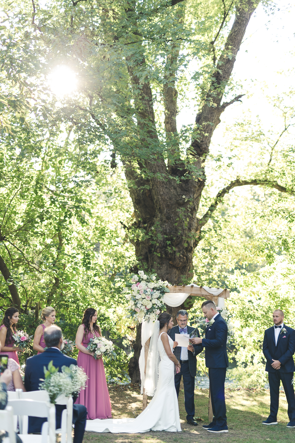 Exchanging vows at Riverdale Manor