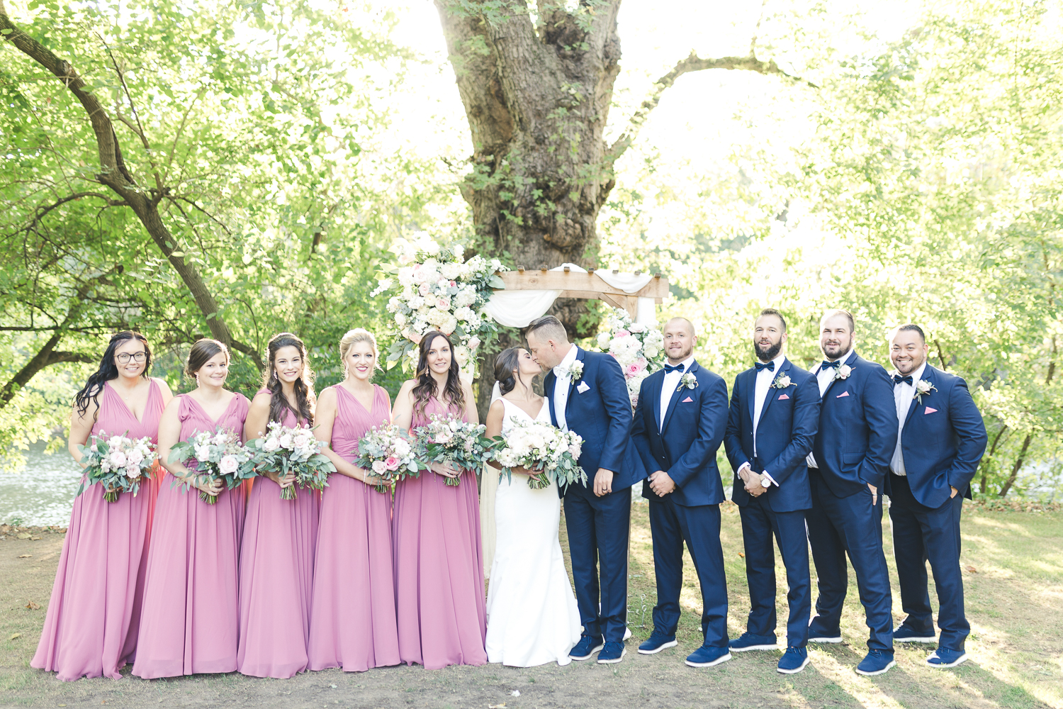 Bride and grooms party group photo