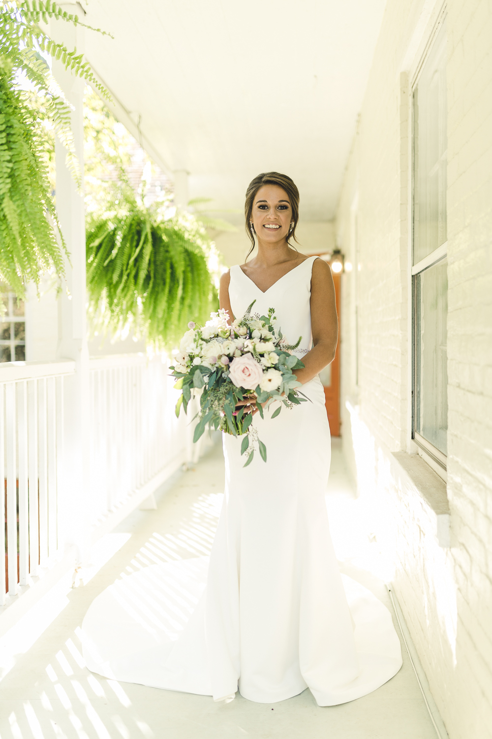 Outdoor balcony bridal portrait