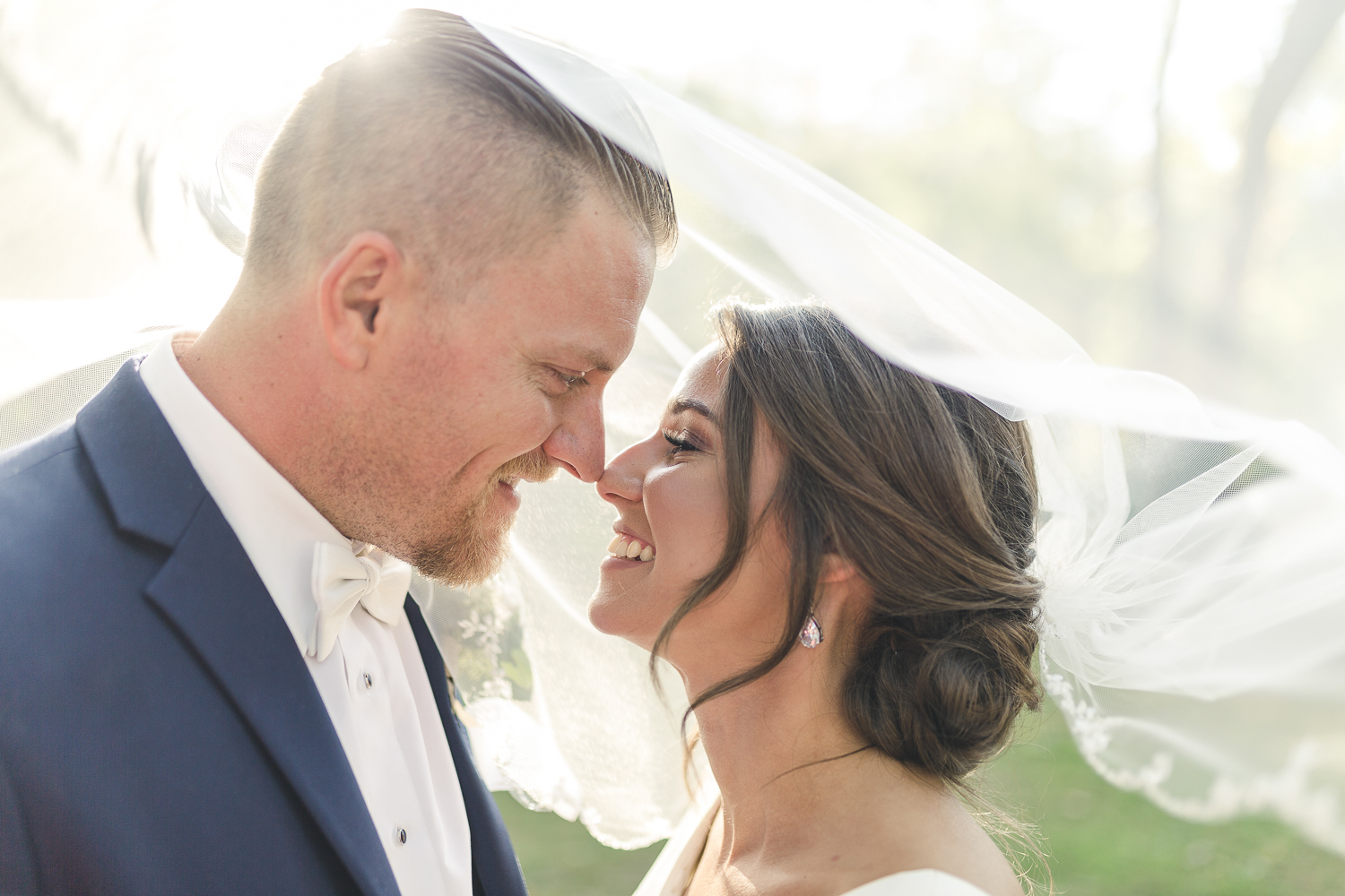Bride and Groom under veil at Riverdale Manor