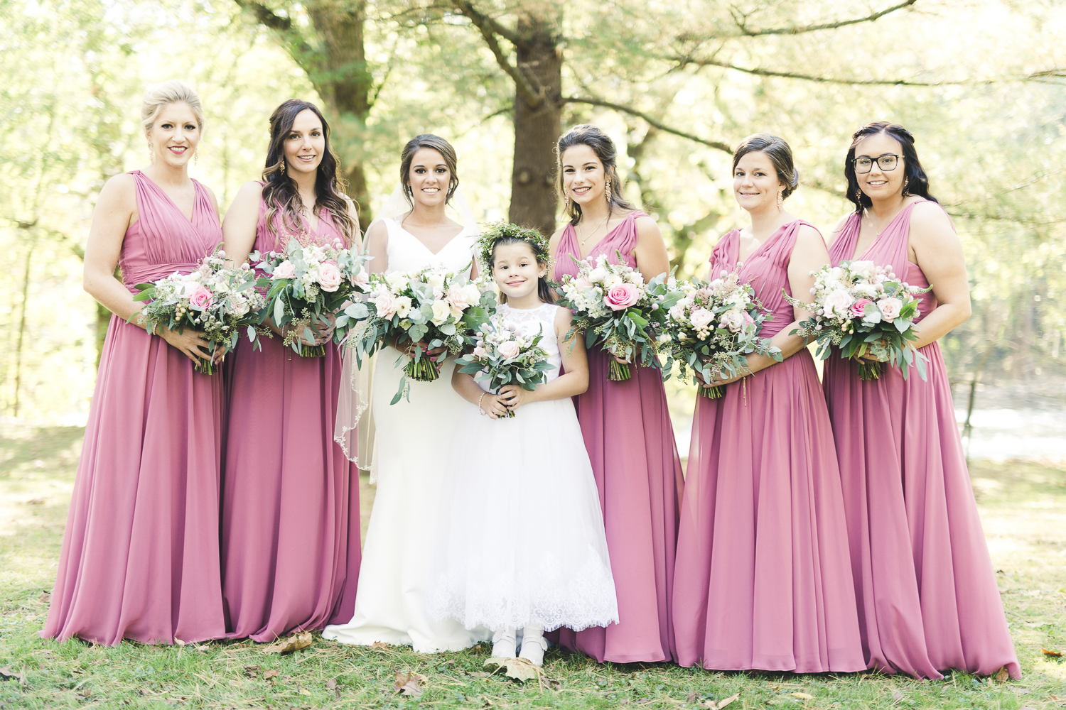 Bride, bridesmaid, and flower girl