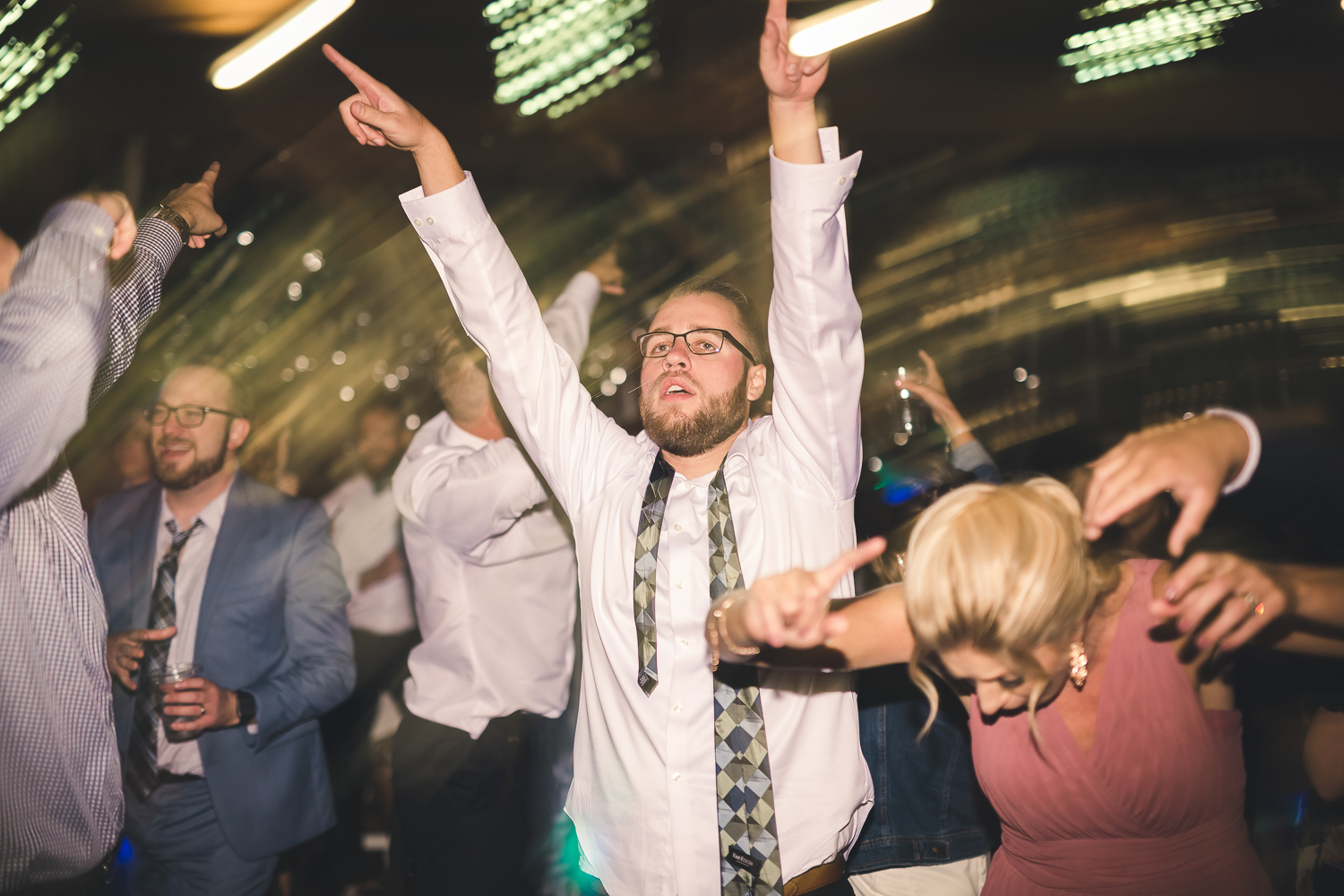 Friends dancing at reception