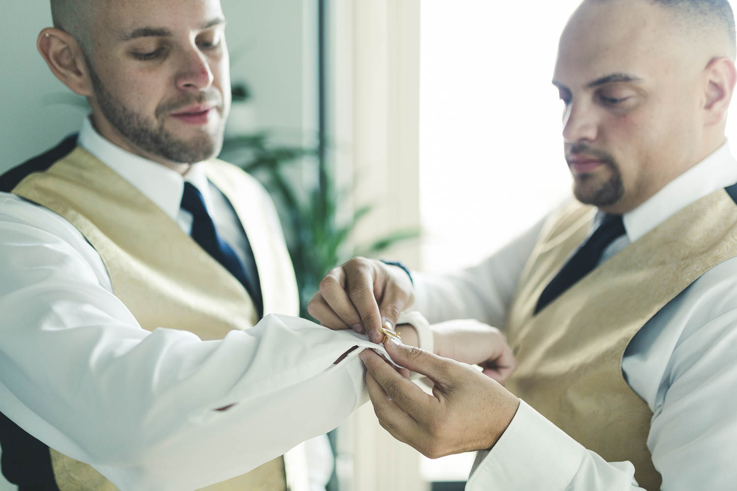 Grooms helping each other get ready