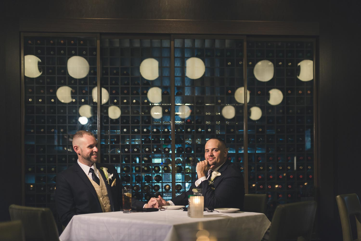 Grooms at dinner table together
