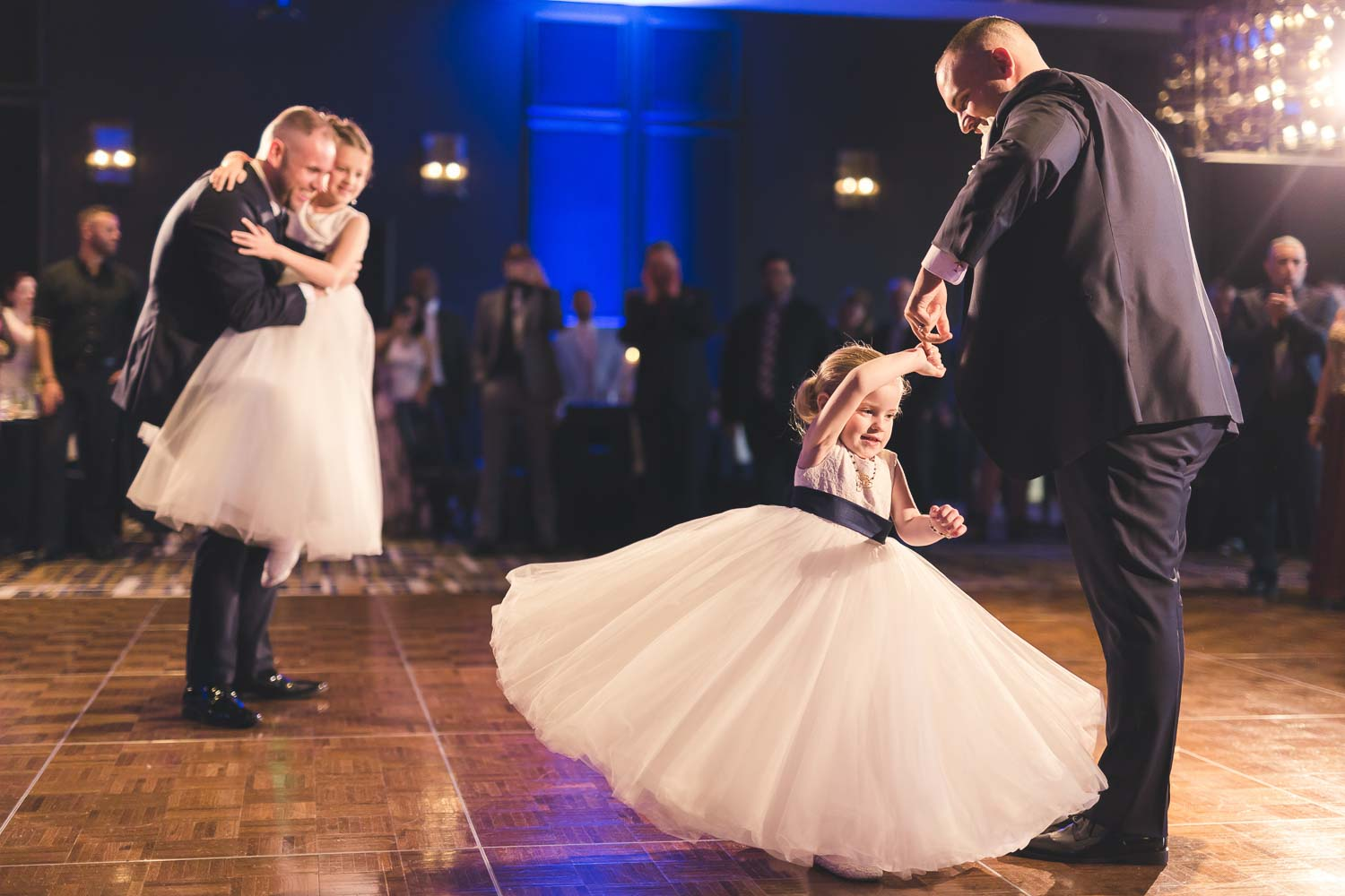 Grooms dancing with flower girls