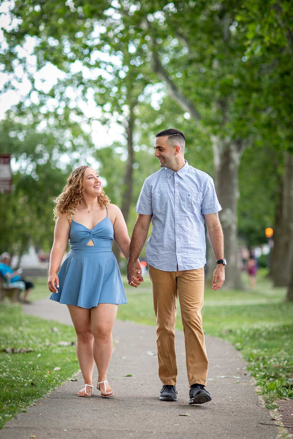 Couples walking in the park at Bristol Wharf