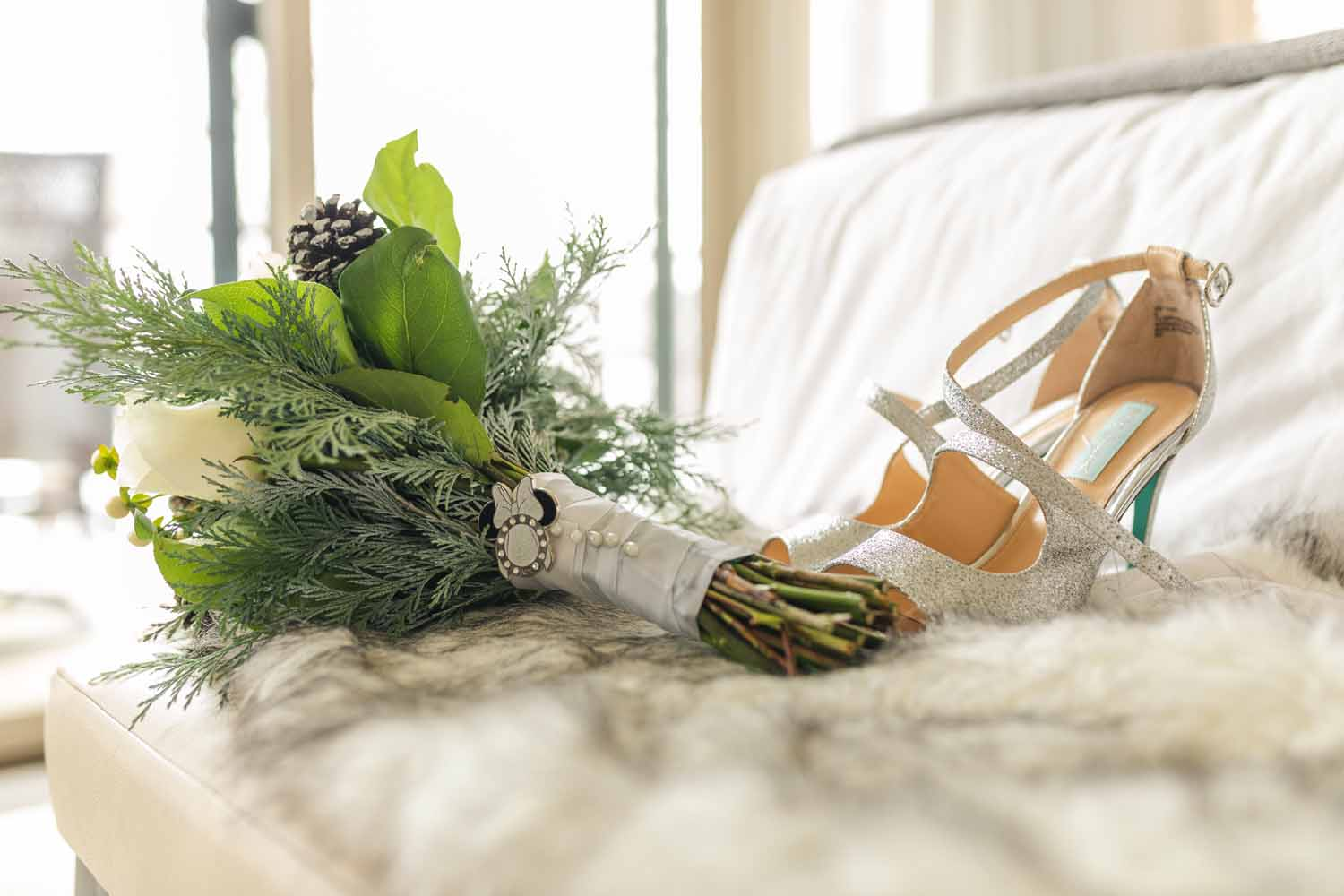 Brides heels and bouquet close up