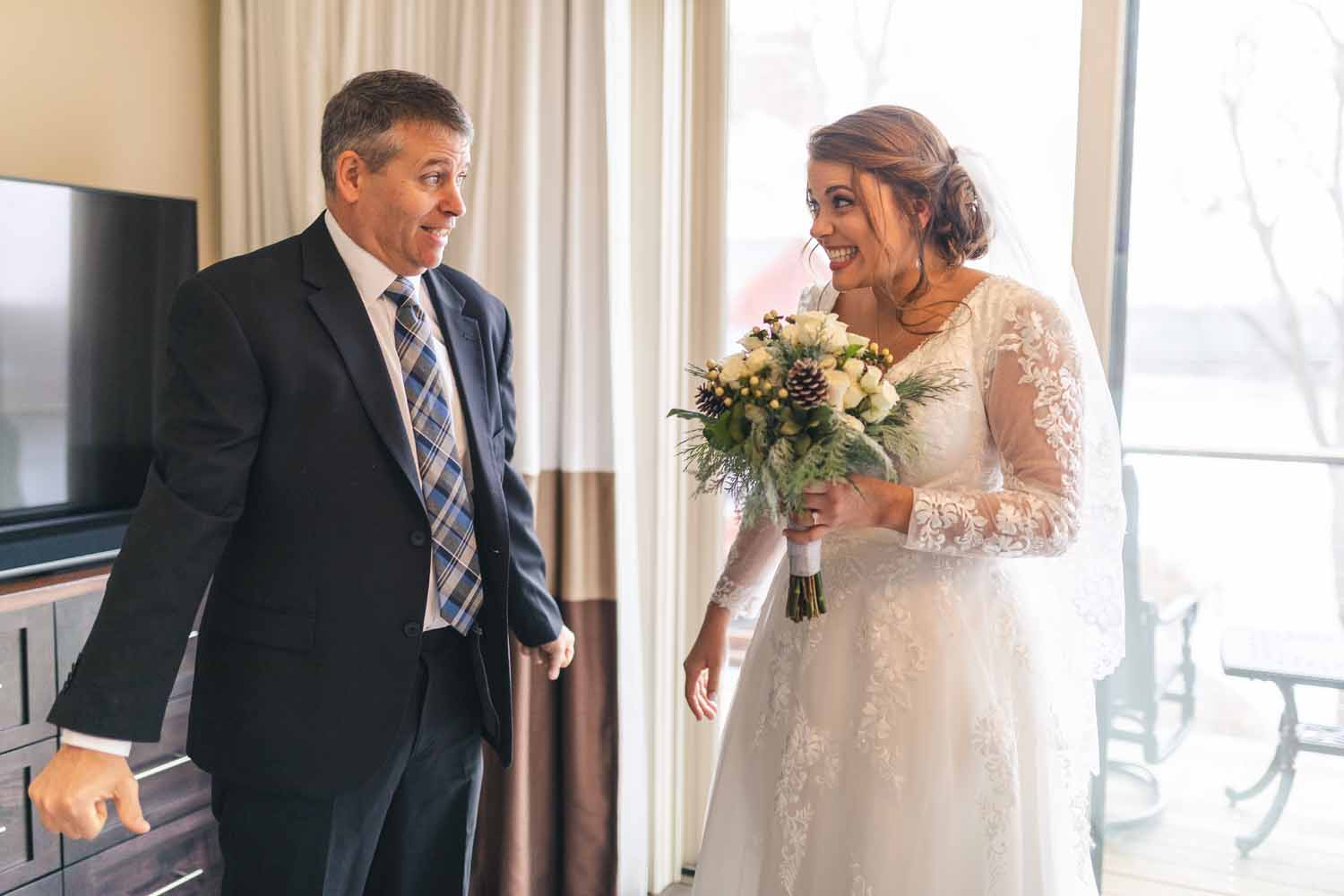 Bride and father making goofy faces at each other