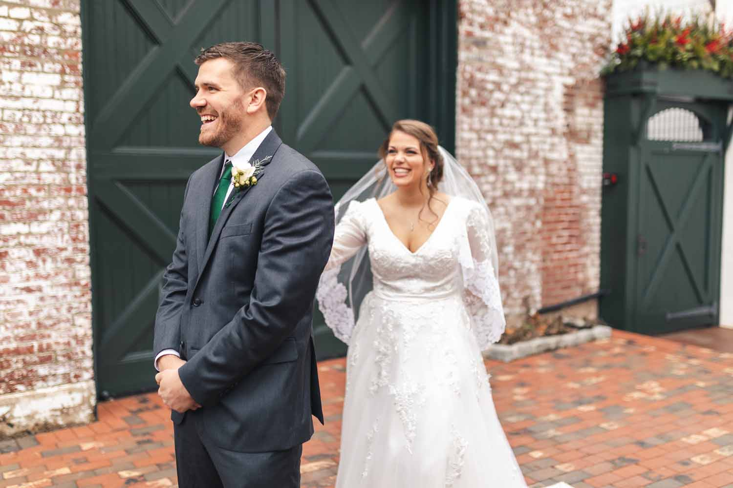 Bride tapping groom on the shoulder before first look