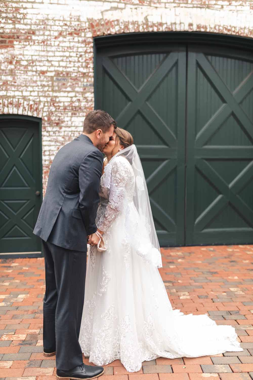 Couple kissing after first look before wedding