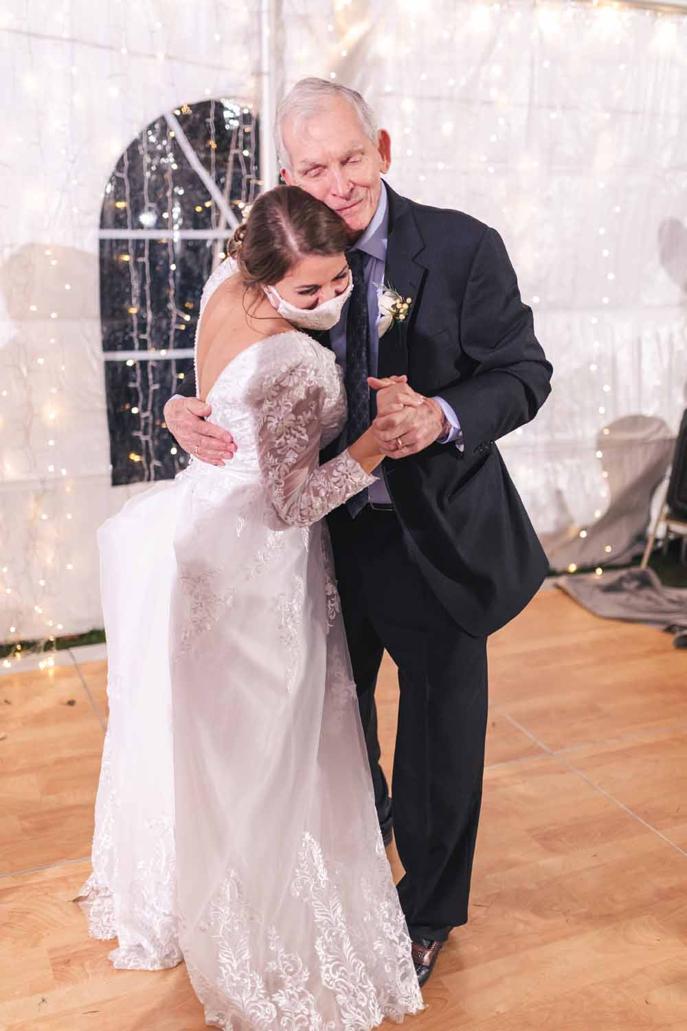 Bride dancing with her grandfather at wedding reception