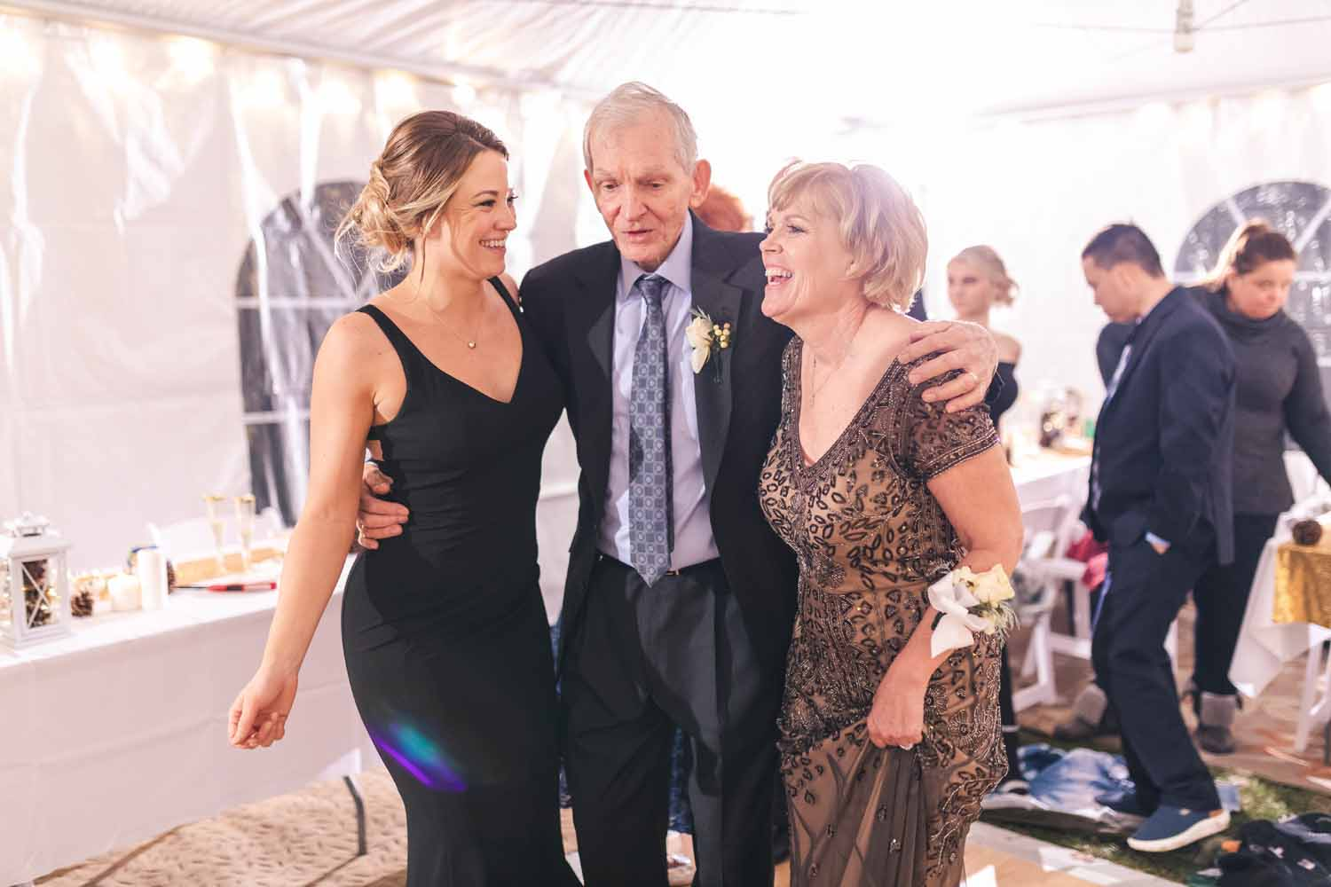 Grandfather dancing with daughter and granddaughter