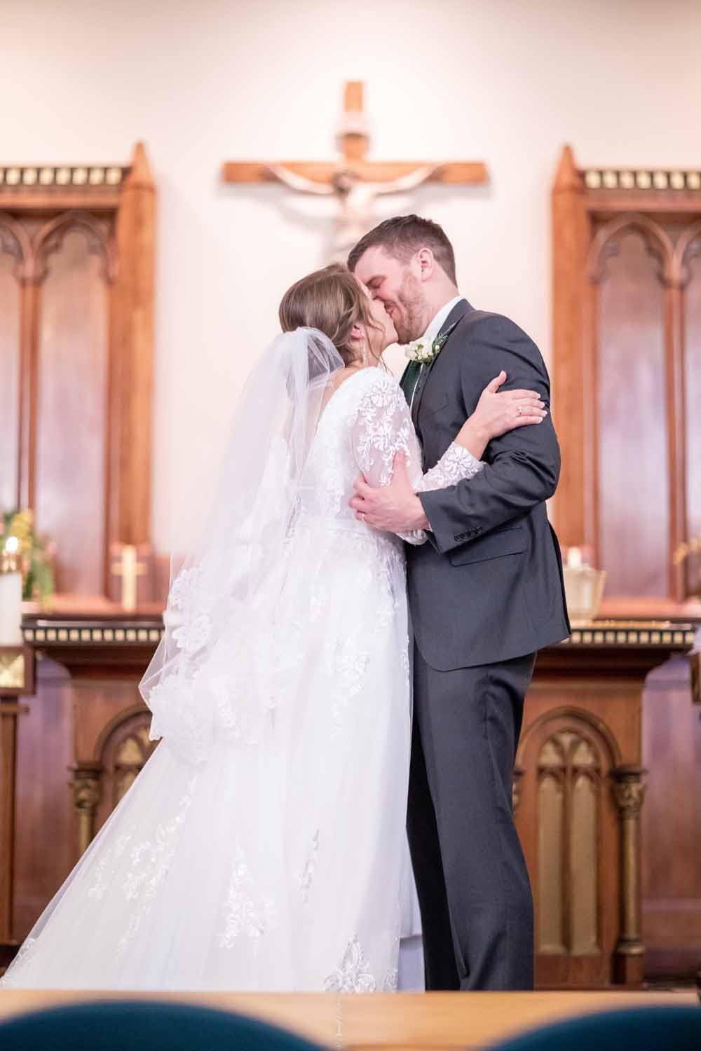 Bride and groom kiss at wedding ceremony at Old St. Andrews in Newtown PA