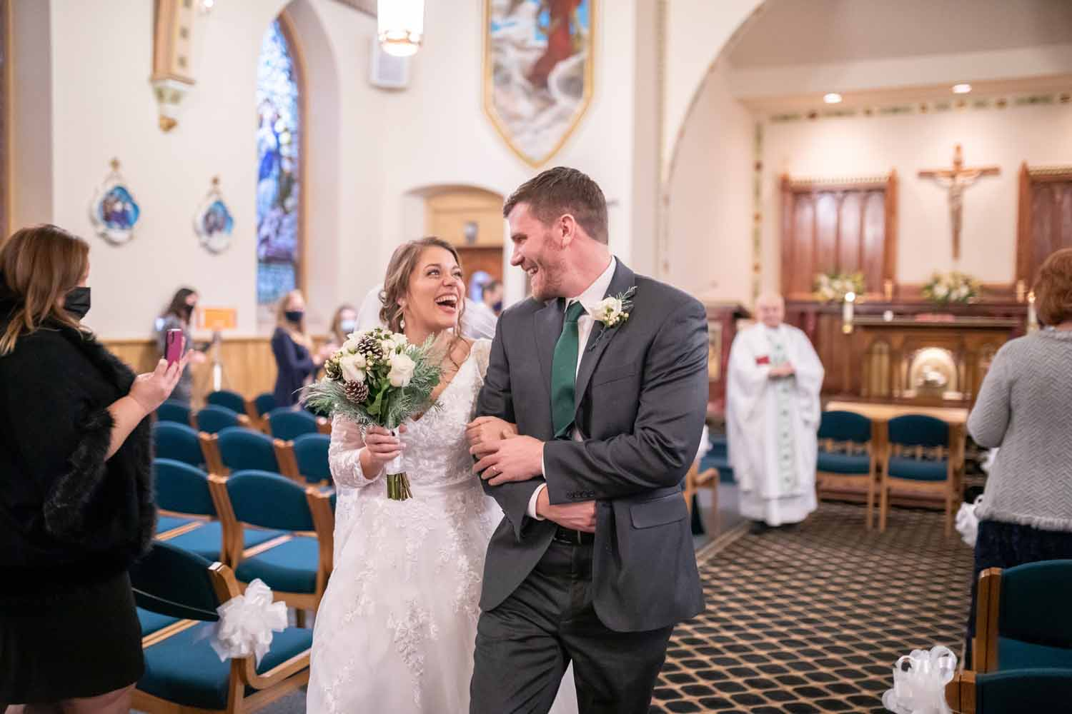 Bride and groom exit church after wedding ceremony