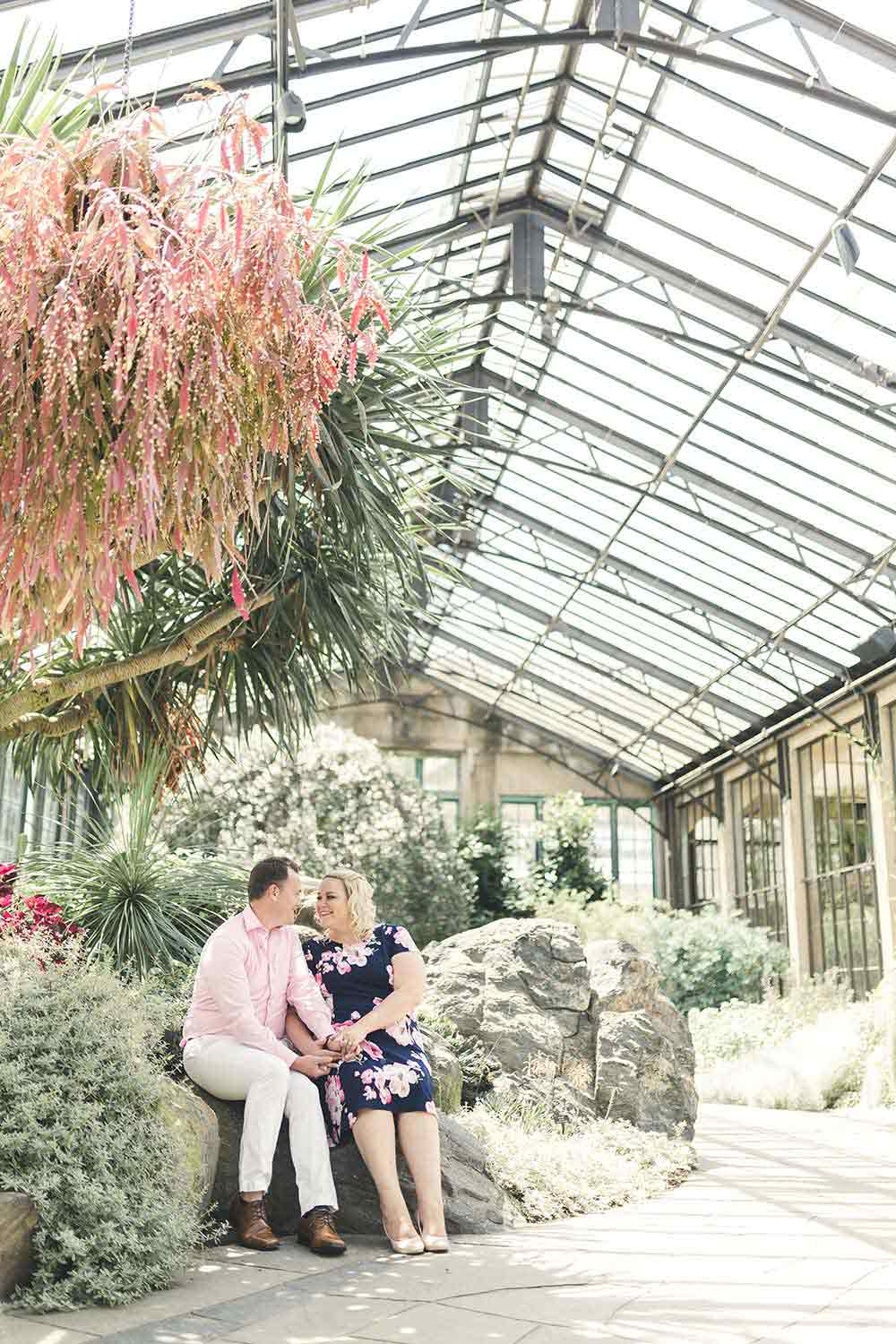 Longwood Gardens Summer Engagement with couple in surrounded by arid climate plants