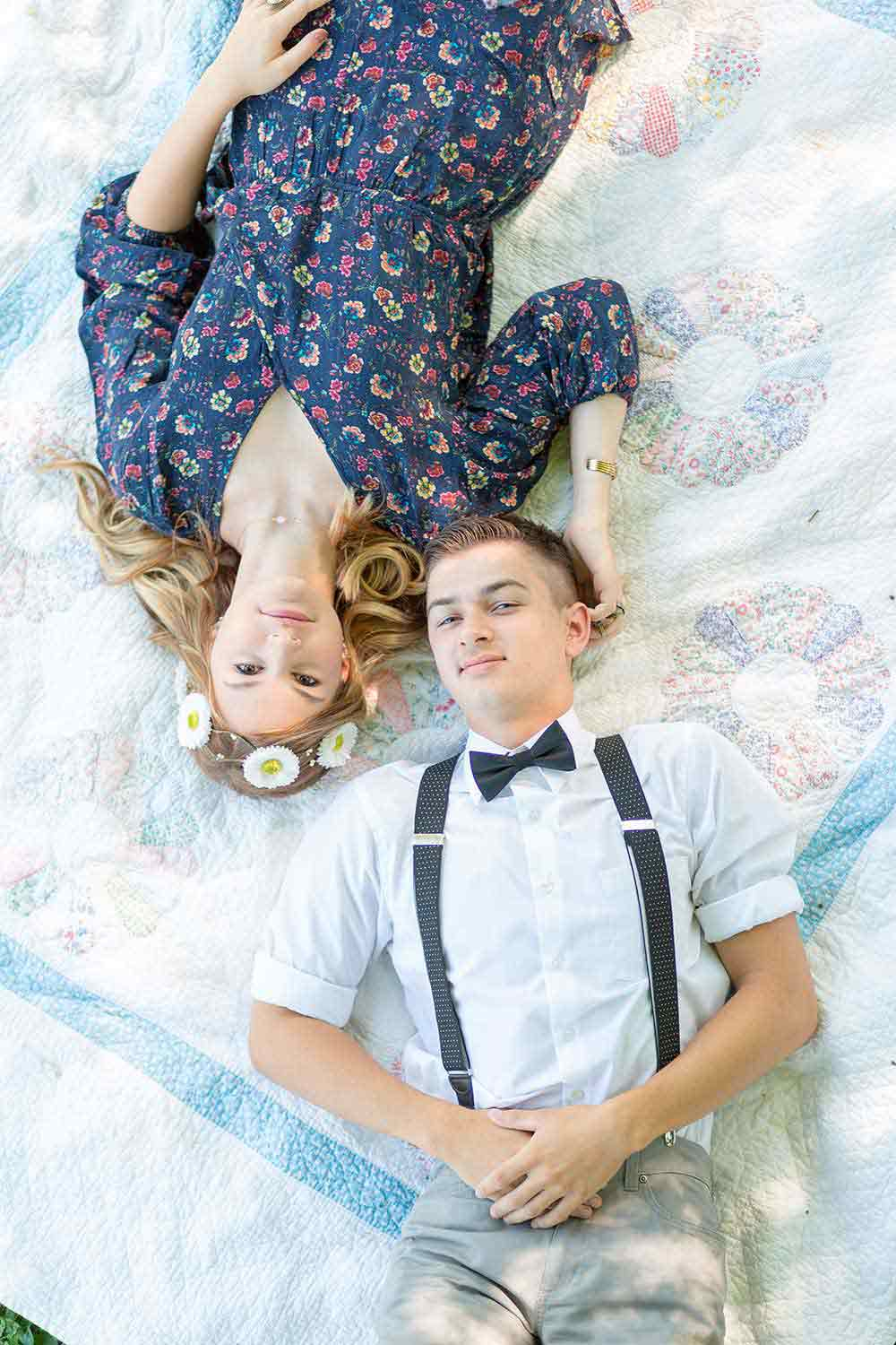 Philadelphia Engagement Photos with couple laying on white picnic blanet together