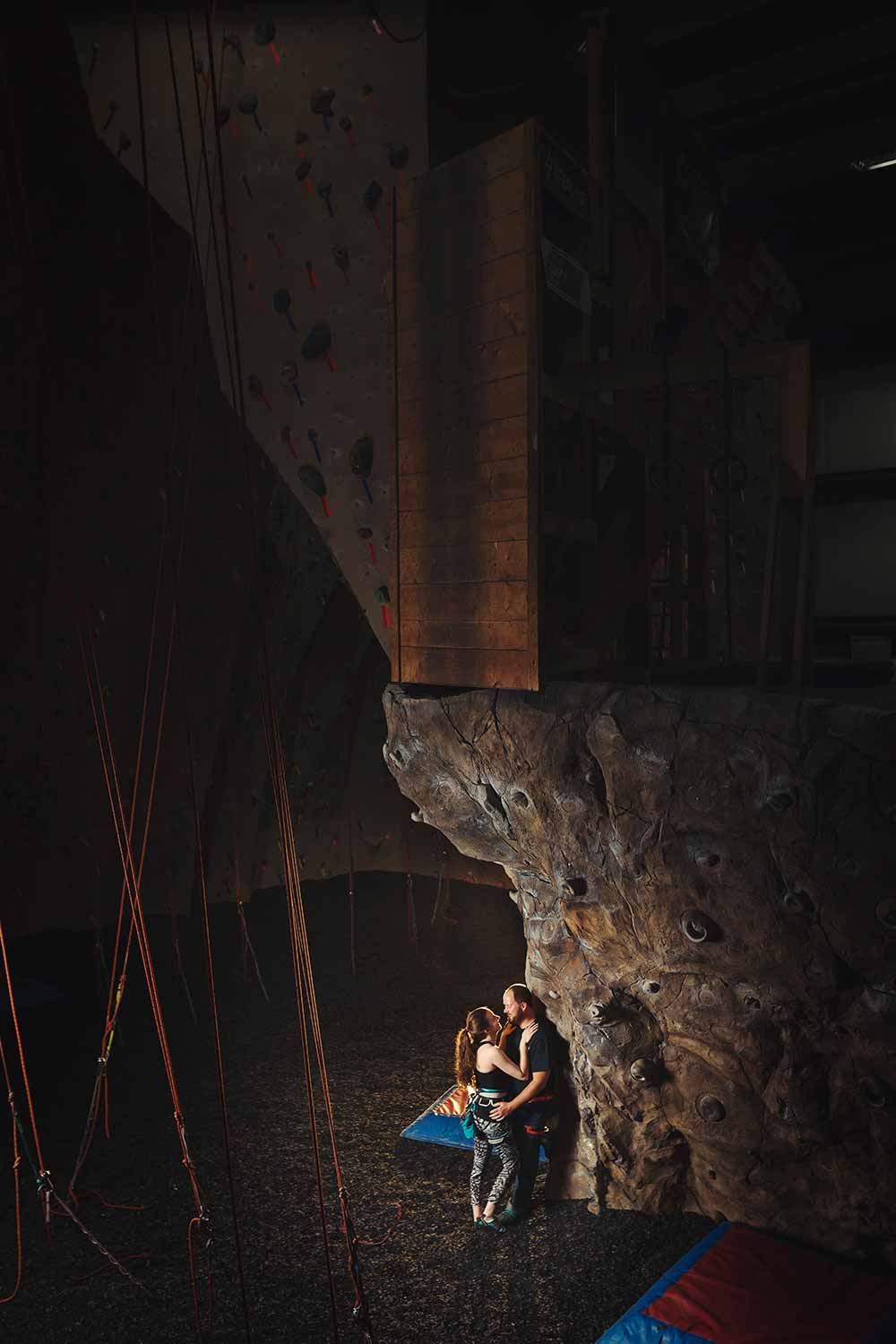 Engagement photo of couple in Reading Rocks climbing gym